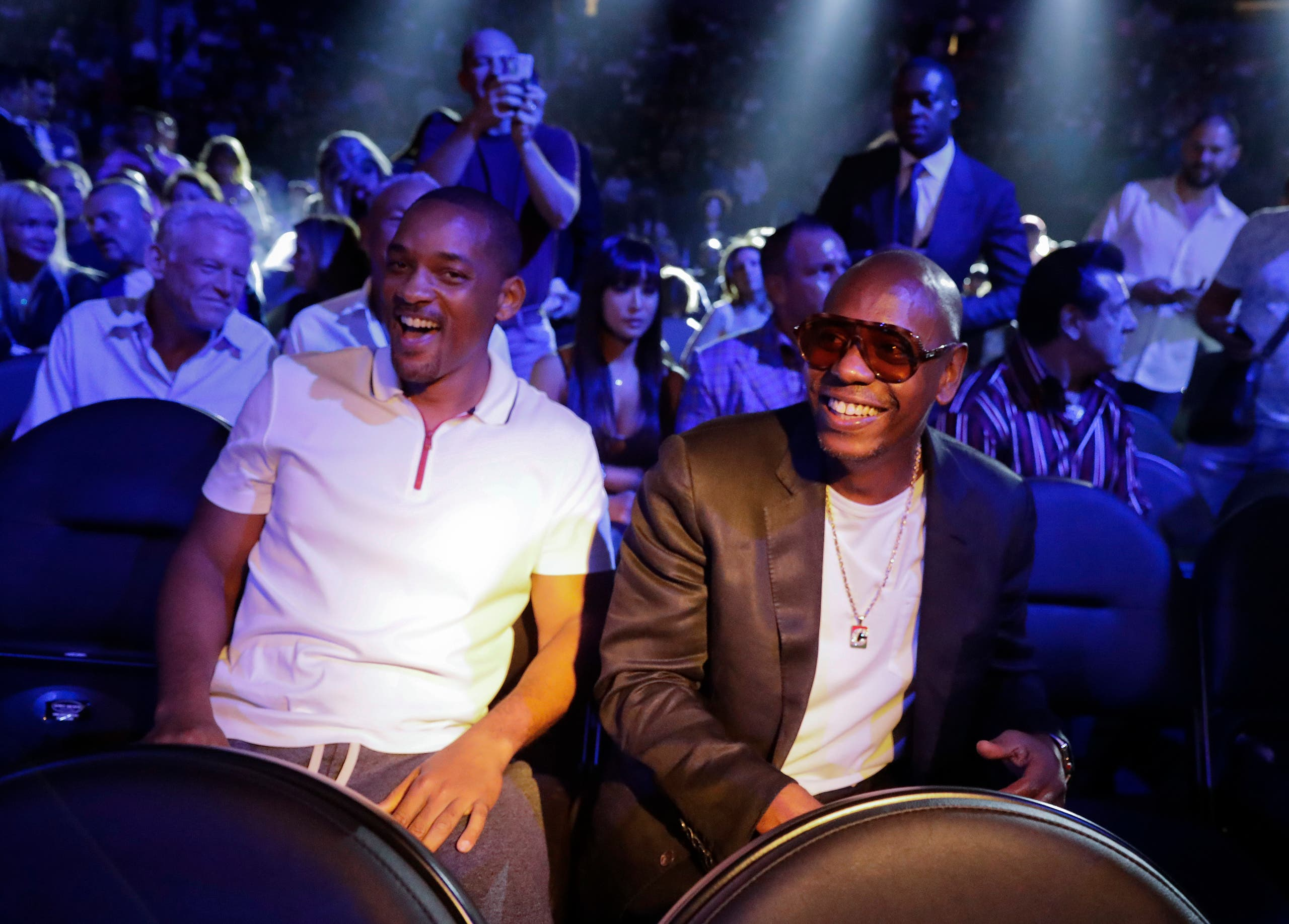 Will Smith, left, and Dave Chapelle wait for the start of a middleweight title fight between Canelo Alvarez and Gennady Golovkin, Saturday, Sept. 15, 2018, in Las Vegas. (AP)