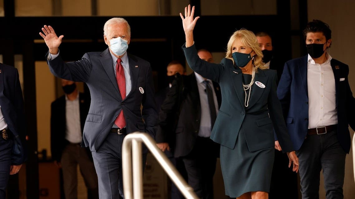 Democratic nominee Joe Biden and his wife Jill wave as they depart after casting their votes in the 2020 presidential election in Wilmington, Delaware, Oct. 28, 2020. (Reuters)