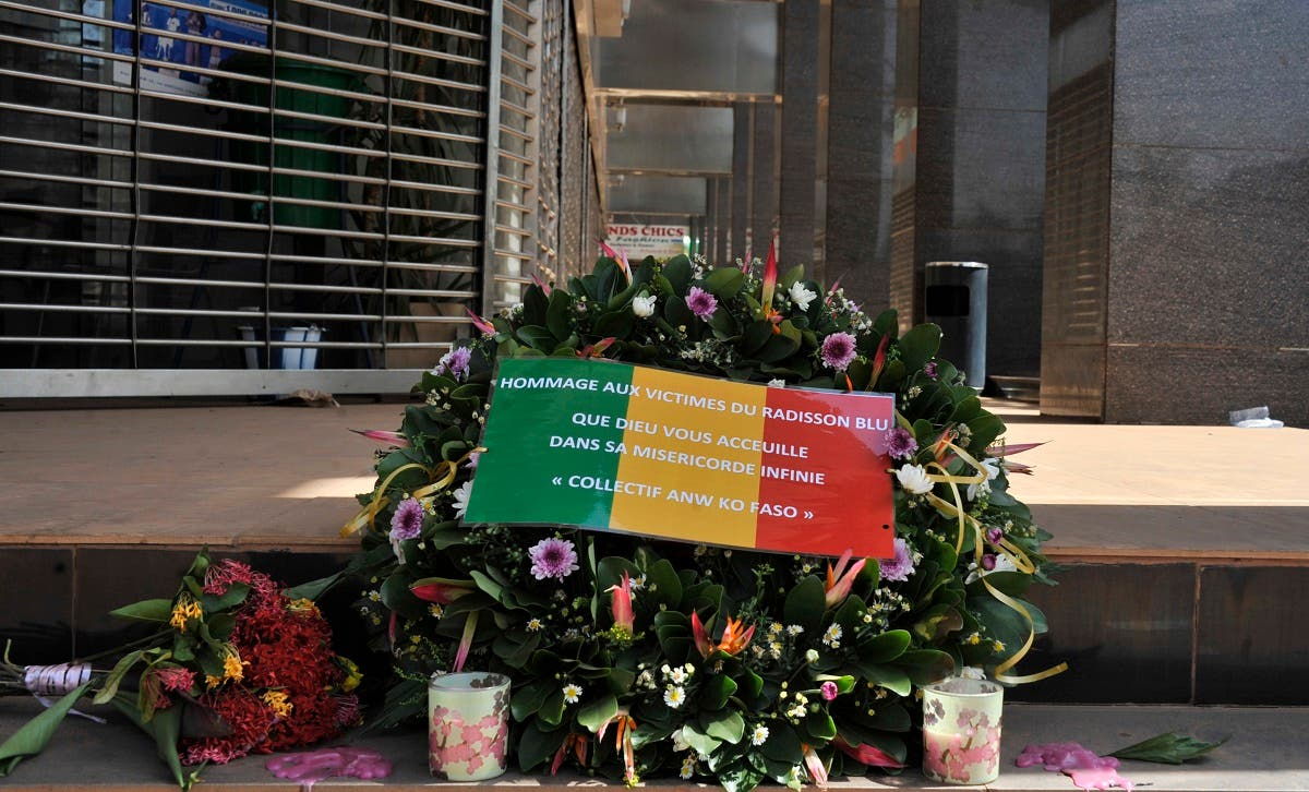 This file photo taken on November 24, 2015 shows the Malian flag reading the words Tribute to the victims of the Radisson Blu, may God welcome you in His infinite mercy laid on a floral wreath at the entrance the hotel in Bamako, after the deadly terrorist attack that left 27 people killed.(Habibou Kouyate/AFP)