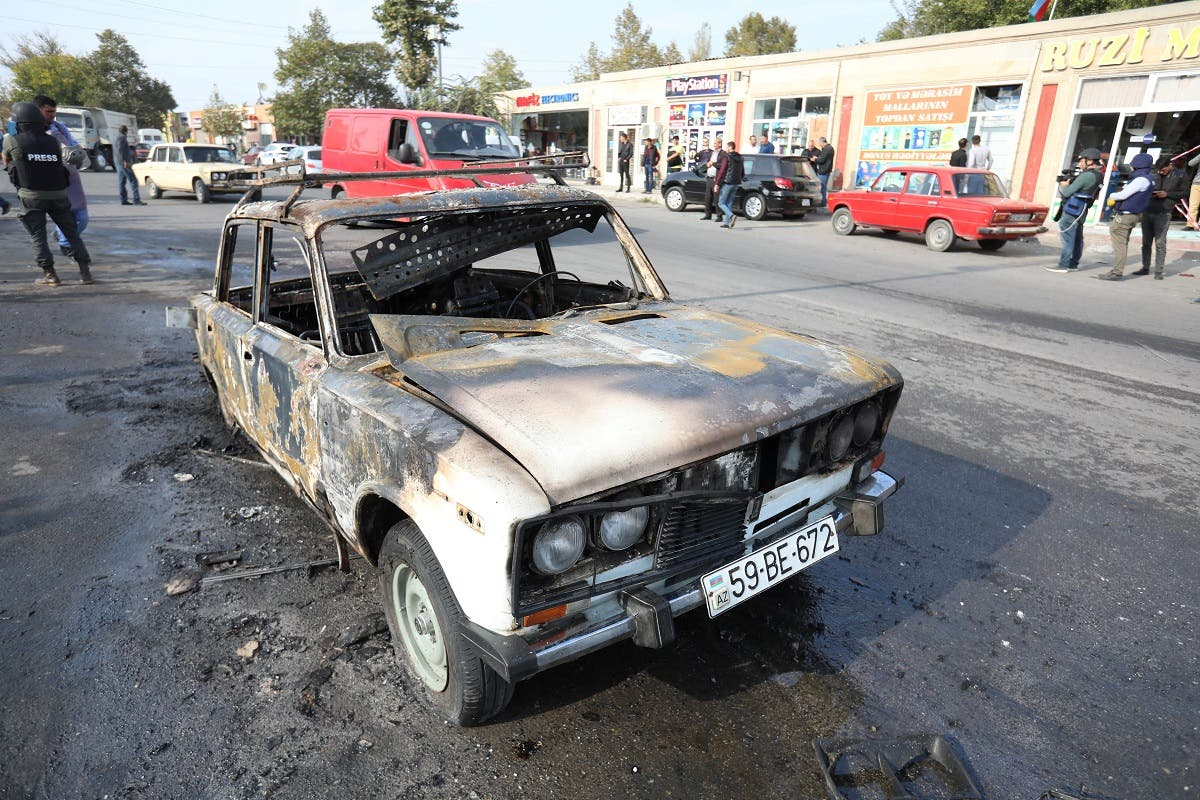 A view shows a burnt car, which was hit by shelling during a military conflict over the breakaway region of Nagorno-Karabakh, in the town of Barda, Azerbaijan October 28, 2020. (Reuters)
