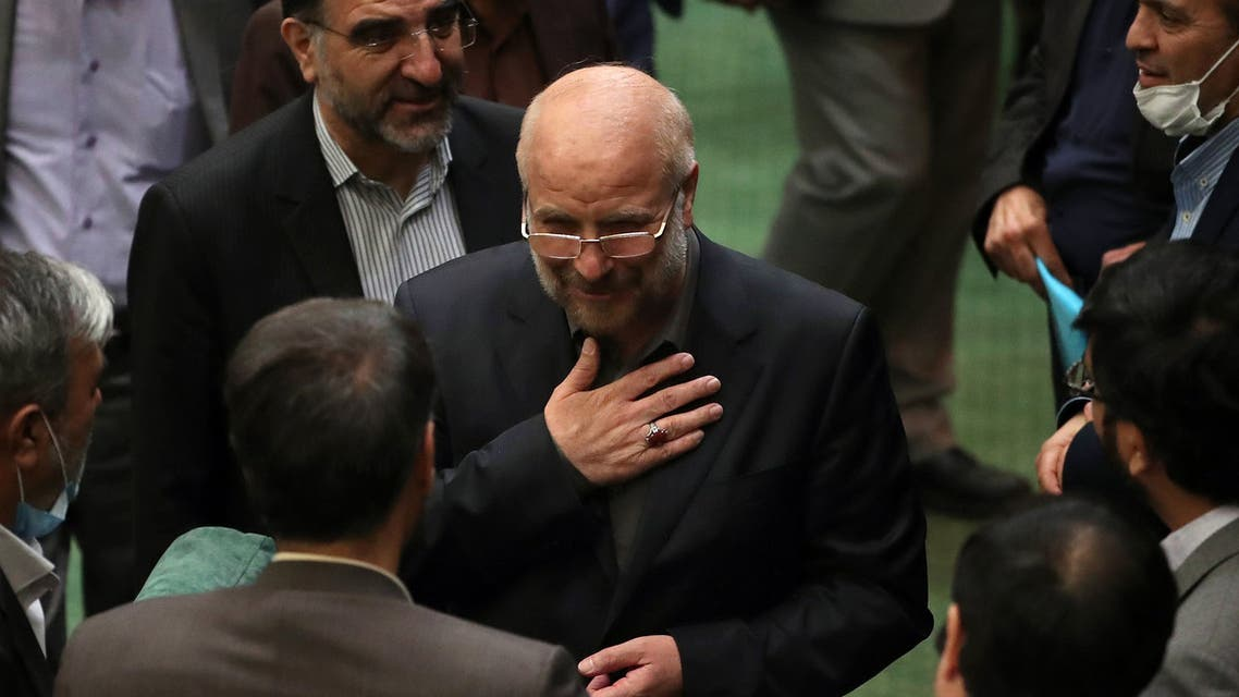 Iranian Mohamad Bagher Ghalibaf (C) stands among members of the parliament after being elected as parliament speaker at the Iranian parliament in Tehran on May 28, 2020. (AFP)