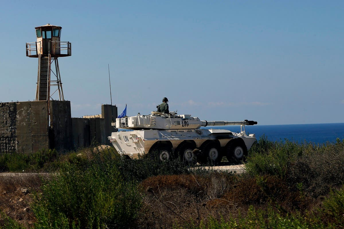 A UN peacekeeper sits atop a tank near the office where Israel and Lebanon meet for indirect talks, in south Lebanon's Naqoura, October 14, 2020. (AP)