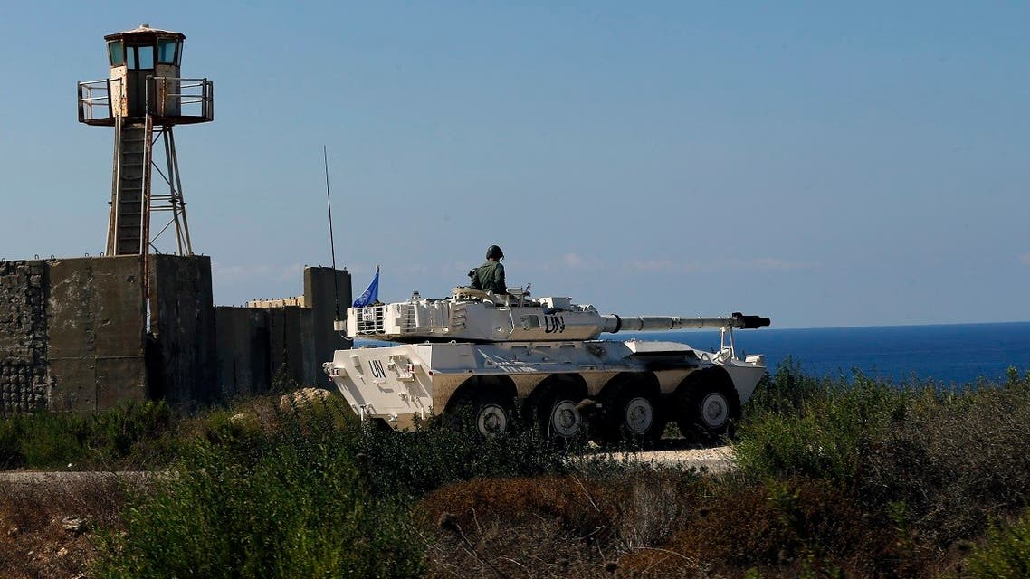 A UN peacekeeper sits atop a tank near the office where Israel and Lebanon meet for indirect talks, in south Lebanon's Naqoura, Oct. 14, 2020. (AP)