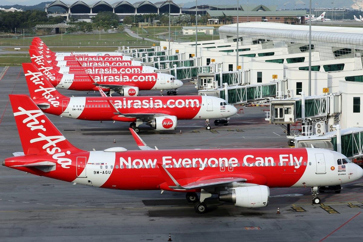 Airasia planes are seen parked at Kuala Lumpur International Airport 2, amid the coronavirus disease outbreak in Sepang, Malaysia October 6, 2020. (Reuters/Lim Huey Teng)