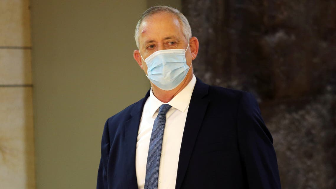 Israeli Defence Minister Benny Gantz wears a protective face mask as he arrives to attend a vote on the approval of the normalisation deal with the United Arab Emirates at the Knesset, Israel's parliament, in Jerusalem October 15, 2020. Alex Kolomoisky/Yedioth Ahronoth?/POOL via REUTERS