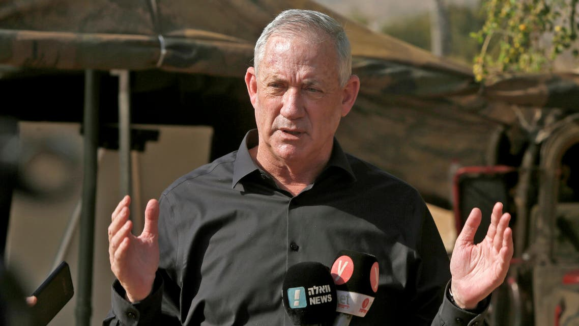 Benny Gantz (R), Israel's Alternate Prime Minister and Defence Minister, mask-clad due to the COVID-19 coronavirus pandemic, arrives to attend the Deadly Arrow military drill near Kibbutz Ravid in the northern part of Israel on October 27, 2020. The largest military drill of the year, Deadly Arrow is meant to simulate a war against Hezbollah as part of efforts to improve the Israeli military's attack capabilities.