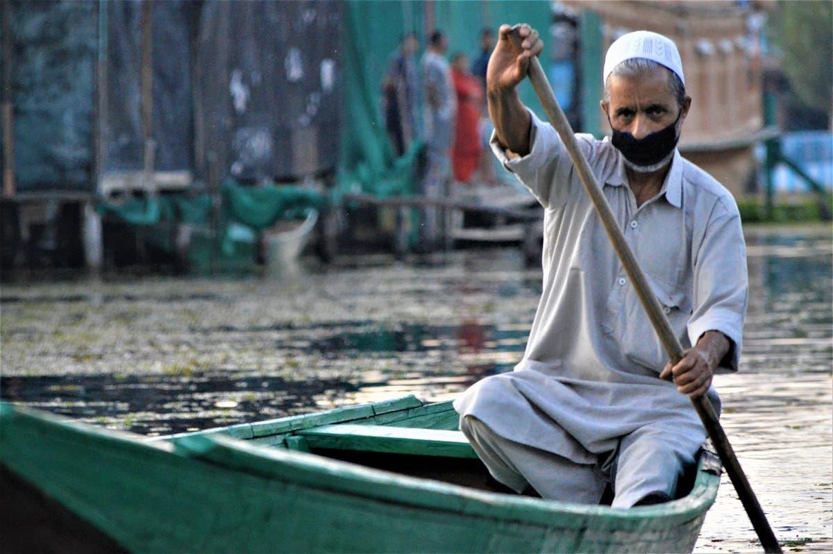 A man rows his boat on Dal Lake in Srinagar, Kashmir, India. (Reuters)