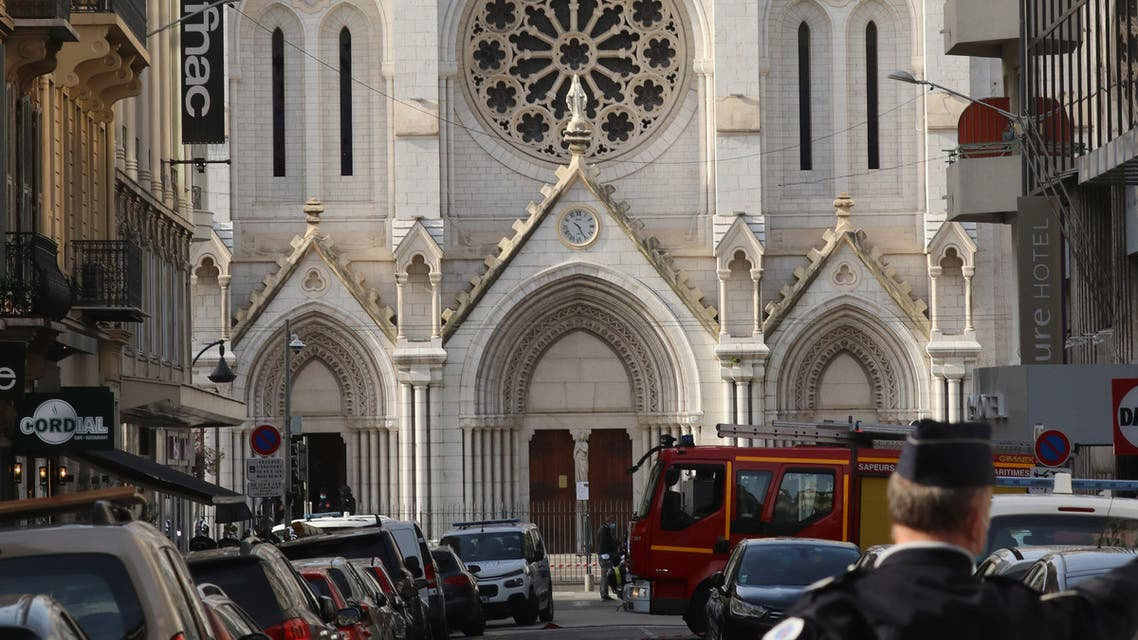 French policemen stand guard a street in front of the Basilica of Notre-Dame de Nice after a knife attack in Nice on October 29, 2020. (AFP)
