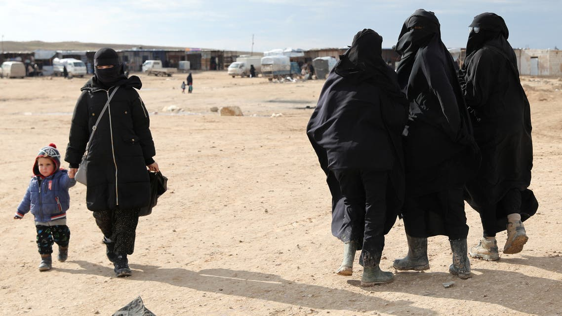 A woman holds hands with a child while walking through al-Hol camp, Syria, January 8, 2020. REUTERS/Goran Tomasevic SEARCH ISLAMIC STATE PRISONERS FOR THIS STORY. SEARCH WIDER IMAGE FOR ALL STORIES.
