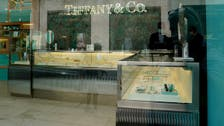 Ending war of words, LVMH and Tiffany agree on $16 billion takeover