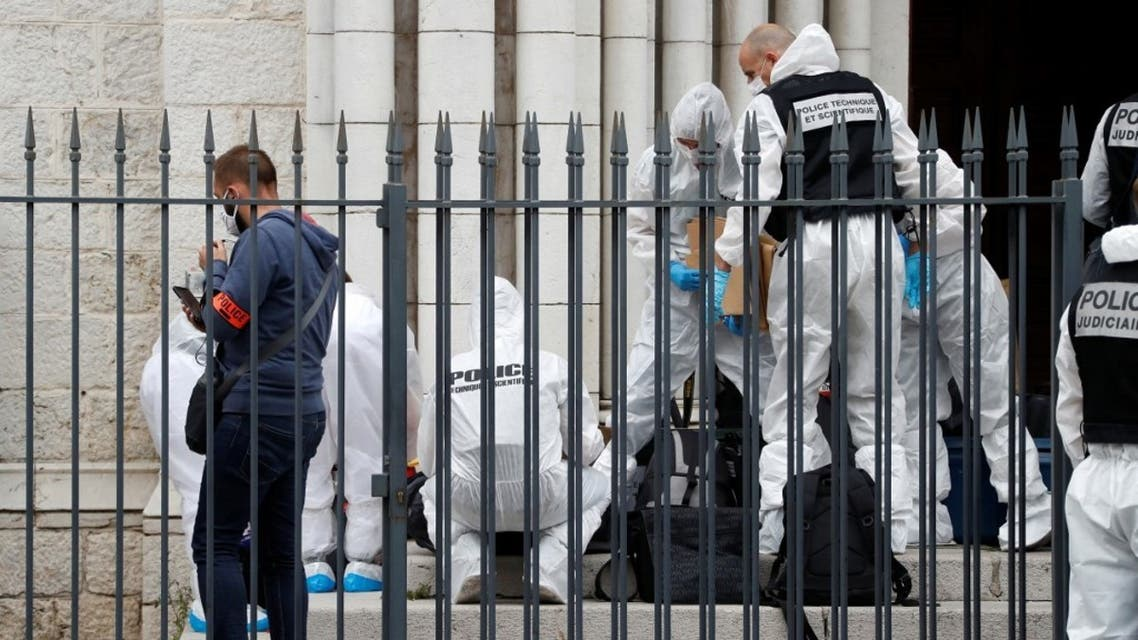 French forensics officers operate outside the Basilica of Notre-Dame de Nice after a knife attack in Nice on October 29, 2020. (AFP)