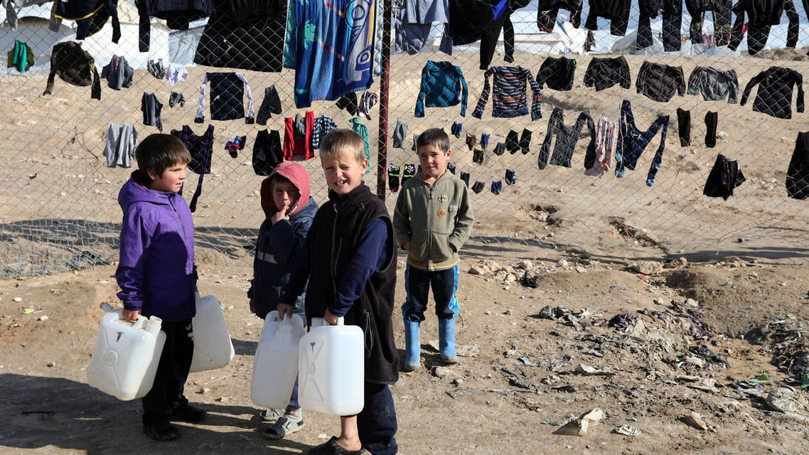 Children hold onto water containers in al-Hol camp, Syria, January 8, 2020. REUTERS/Goran Tomasevic SEARCH ISLAMIC STATE PRISONERS FOR THIS STORY. SEARCH WIDER IMAGE FOR ALL STORIES.
