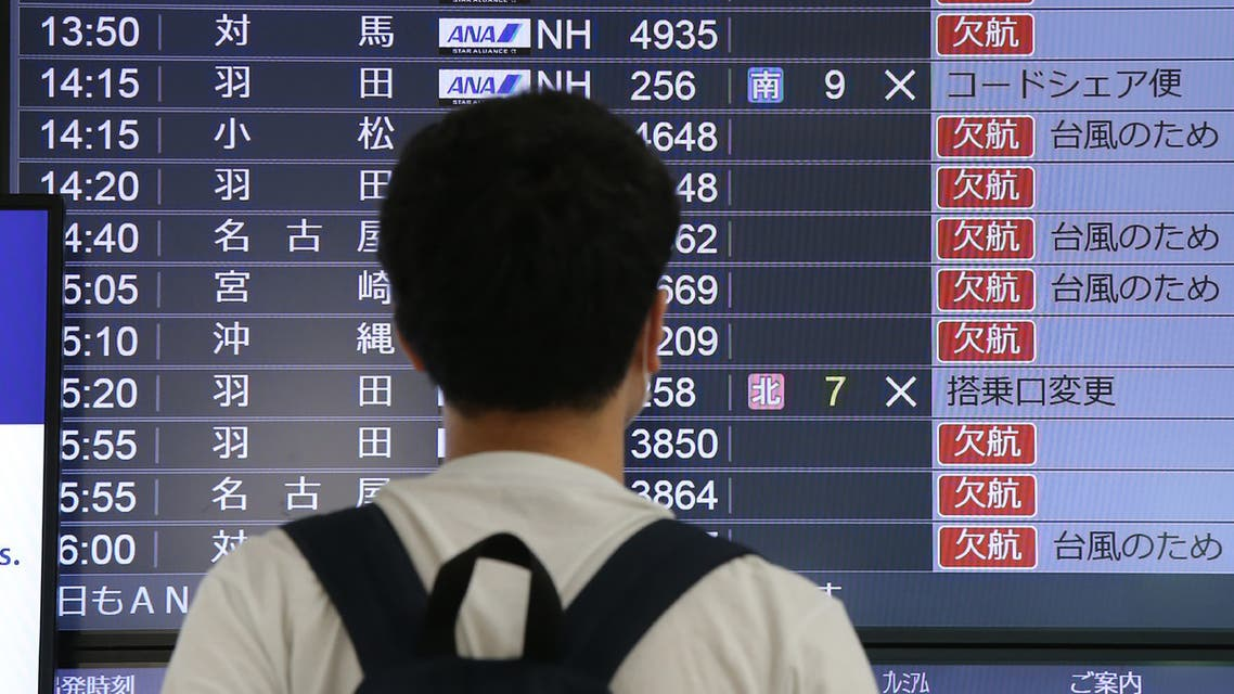 Cancelled flights are seen on a screen at Fukuoka Airport as Typhoon Haishen approaches on September 6, 2020. (AFP)