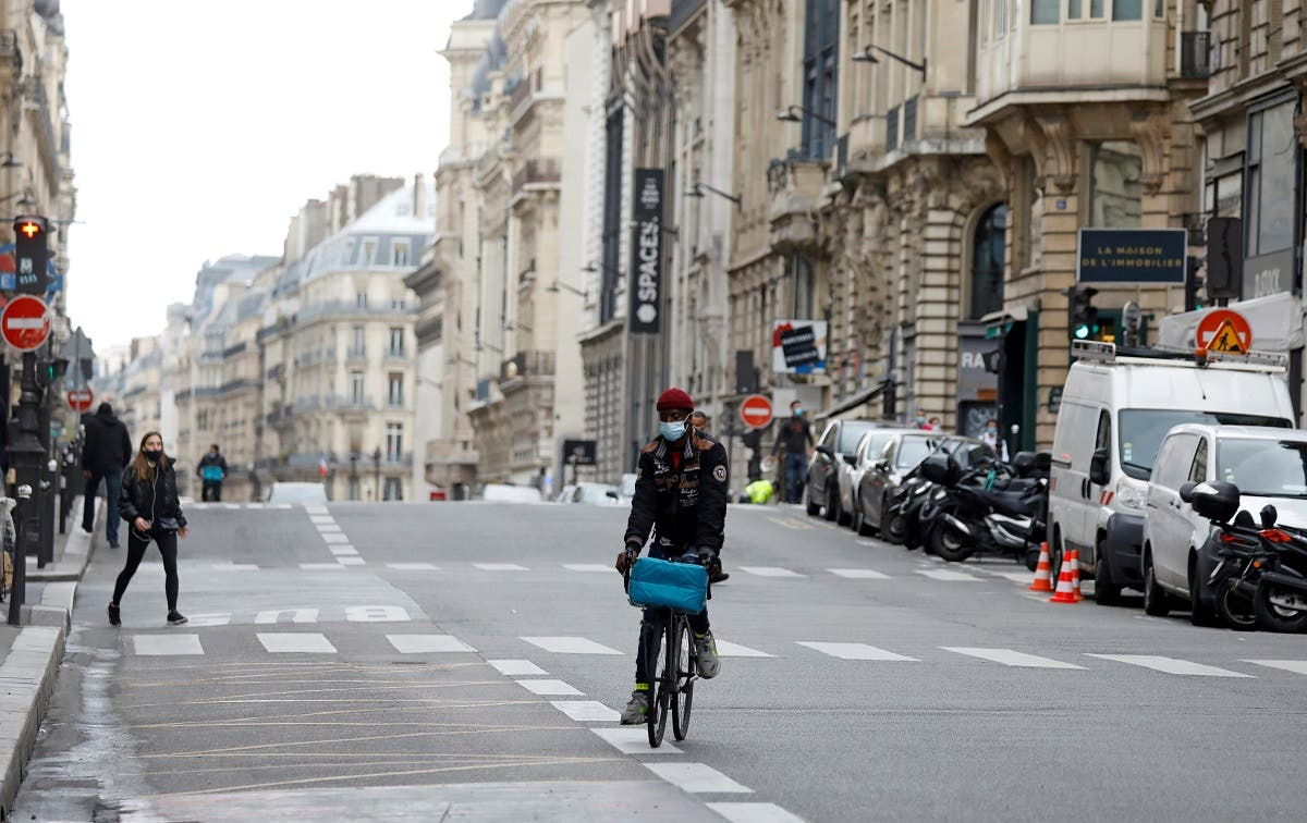 A man rides a bicycle in an almost deserted street in Paris on the first day of the second national lockdown as part of the COVID-19 measures, Paris, France, October 30, 2020. (Reuters)