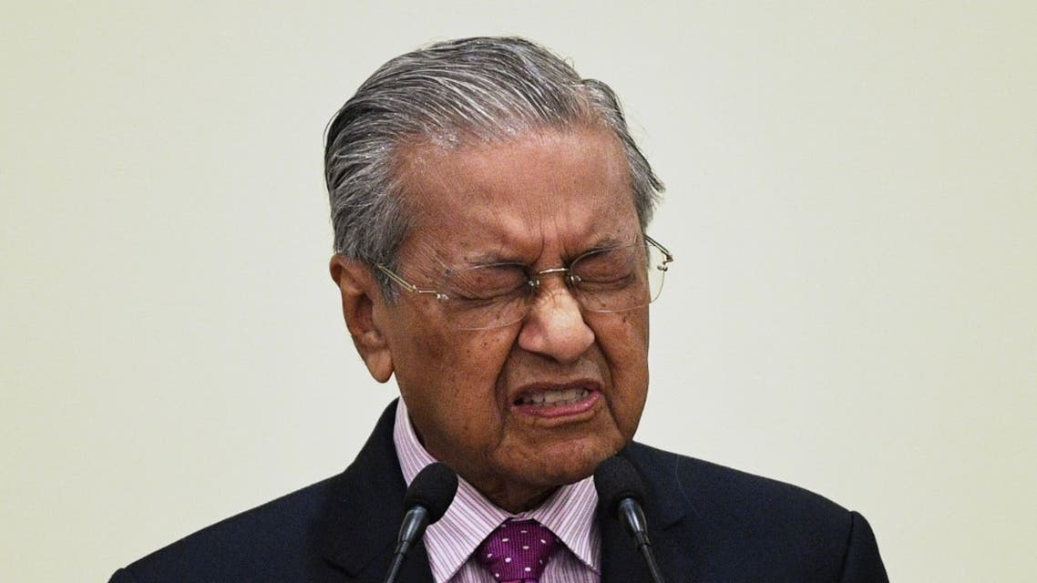 Malaysia's former Prime Minister Mahathir Mohamad answers questions during a press conference at the Prime Minister's Office in Putrajaya on February 27, 2020. (AFP)
