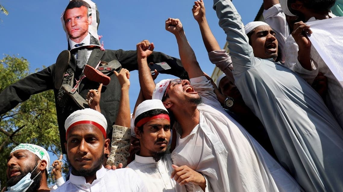 An effigy depicting the French president Emmanuel Macron is seen as Muslims chant slogans after Friday prayer during a protest calling for the boycott of French products and denouncing Macron for his comments over Prophet Mohammed's caricatures, in Dhaka, Bangladesh, on October 30, 2020. (Reuters)