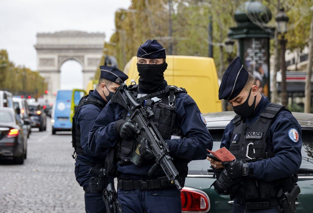 French police officers on the Champs-Elysee avenue in Paris, on October 30, 2020. (AFP)