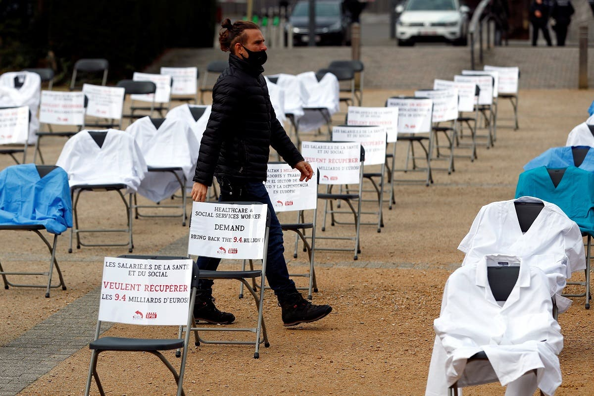 -Nurse clothes and signs are displayed during a symbolic action by the European Federation of Public Service Unions (EPSU), calling EU leaders to fund the health program budget in Brussels, as the spread of the coronavirus  continues, in Brussels, Belgium, on October 29, 2020. (Reuters)