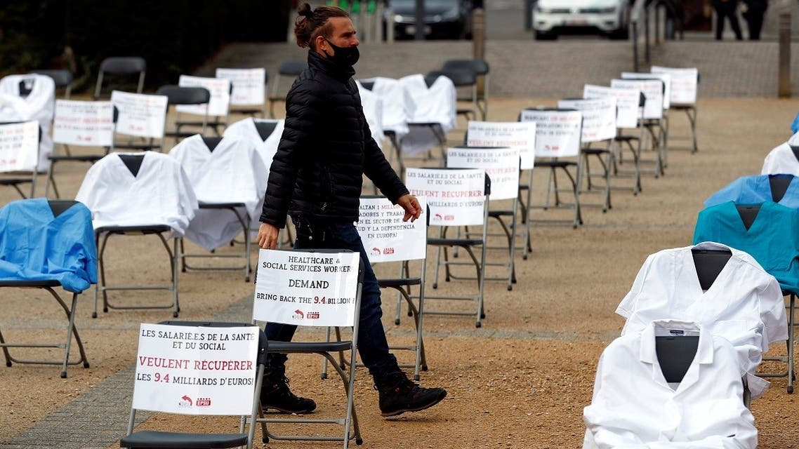 Nurse clothes and signs are displayed during a symbolic action by the European Federation of Public Service Unions (EPSU), calling EU leaders to fund the health program budget in Brussels, amid the coronavirus spread, Brussels, Belgium, on October 29, 2020. (Reuters)