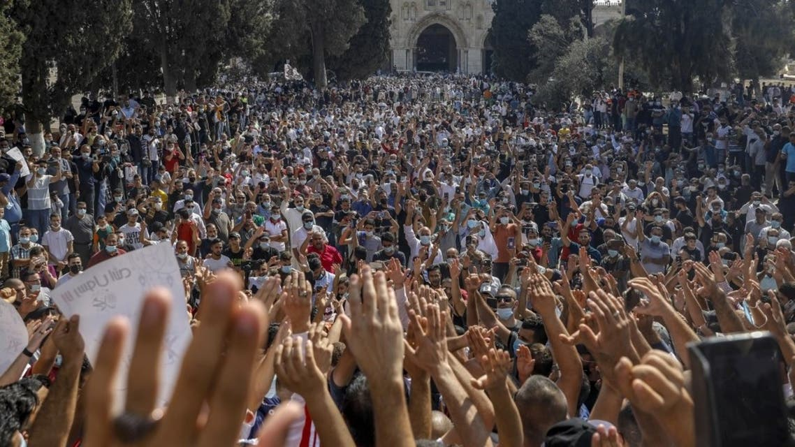 Palestinians gather to protest against the French president, in the al-Aqsa mosque compound, in the Old City of Jerusalem on October 30, 2020. (AFP)