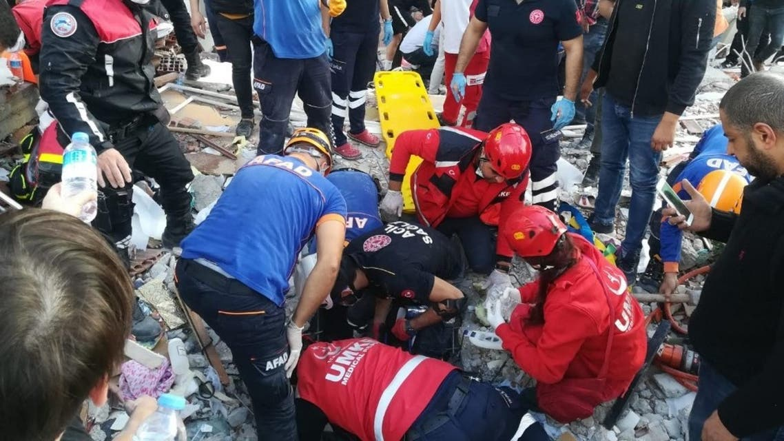Rescuers search for survivors at a collapsed building after a powerful earthquake struck Turkey's western coast and parts of Greece, in Izmir, on October 30, 2020. (AFP)