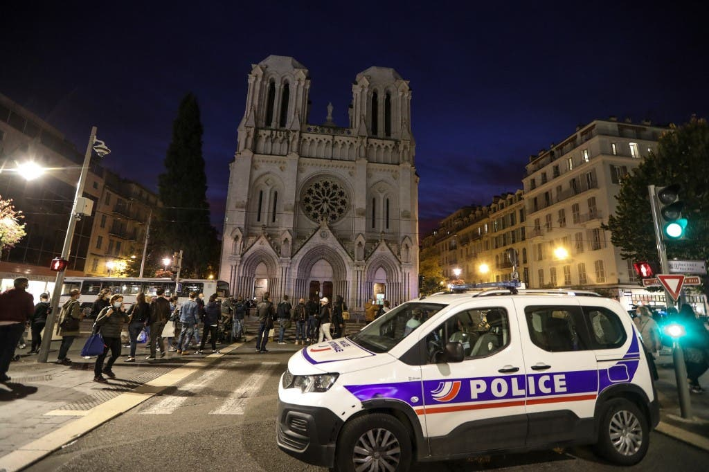 A Police vehicle is parked by the Notre-Dame de l'Assomption Basilica in Nice on October 29, 2020. (AFP)