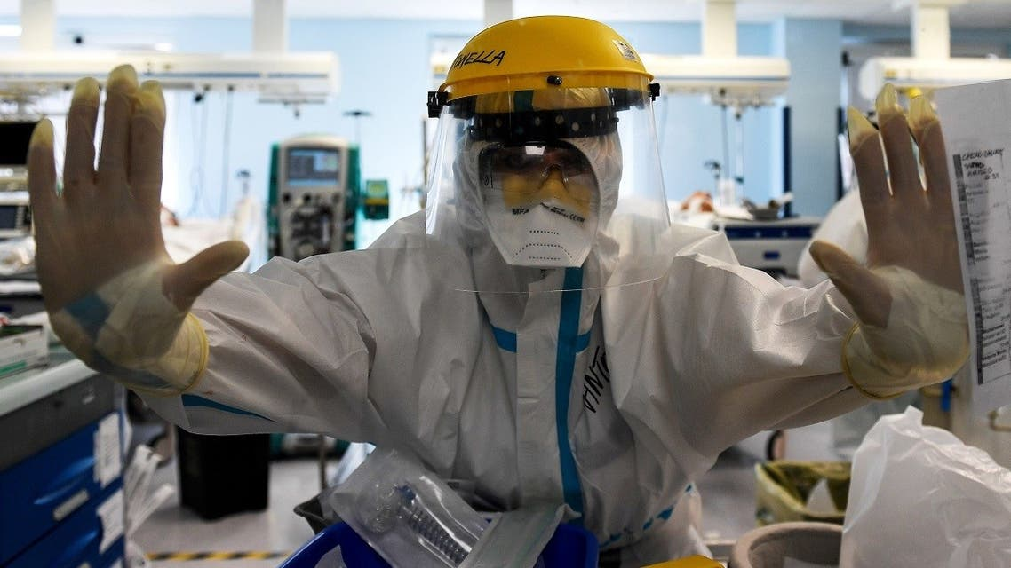A member of medical staff wearing PPE reacts in the Intensive Care Unit (ICU) for the Covid-19 cases, in the San Filippo Neri hospital in Rome, Oct. 29, 2020. (AFP)