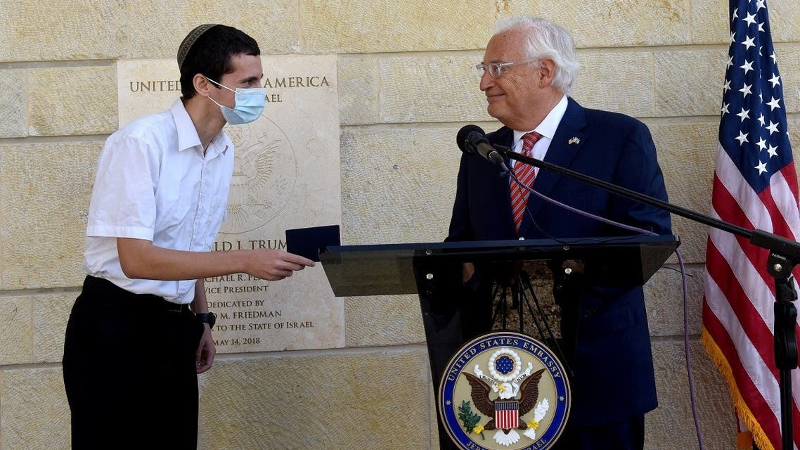 US Ambassador to Israel David Friedman presents Menachem Zivotofsky, a US citizen born in Jerusalem, his passport that lists Israel as birthplace at the US Embassy in Jerusalem, Oct. 30, 2020. (Reuters)