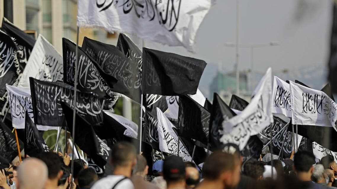 Lebanese demonstrators lift Islamic flags at a rally to protest comments by the French President seen as offensive to Islam, near the residence of the French Ambassador in the capital Beirut, on October 30, 2020. (AFP)
