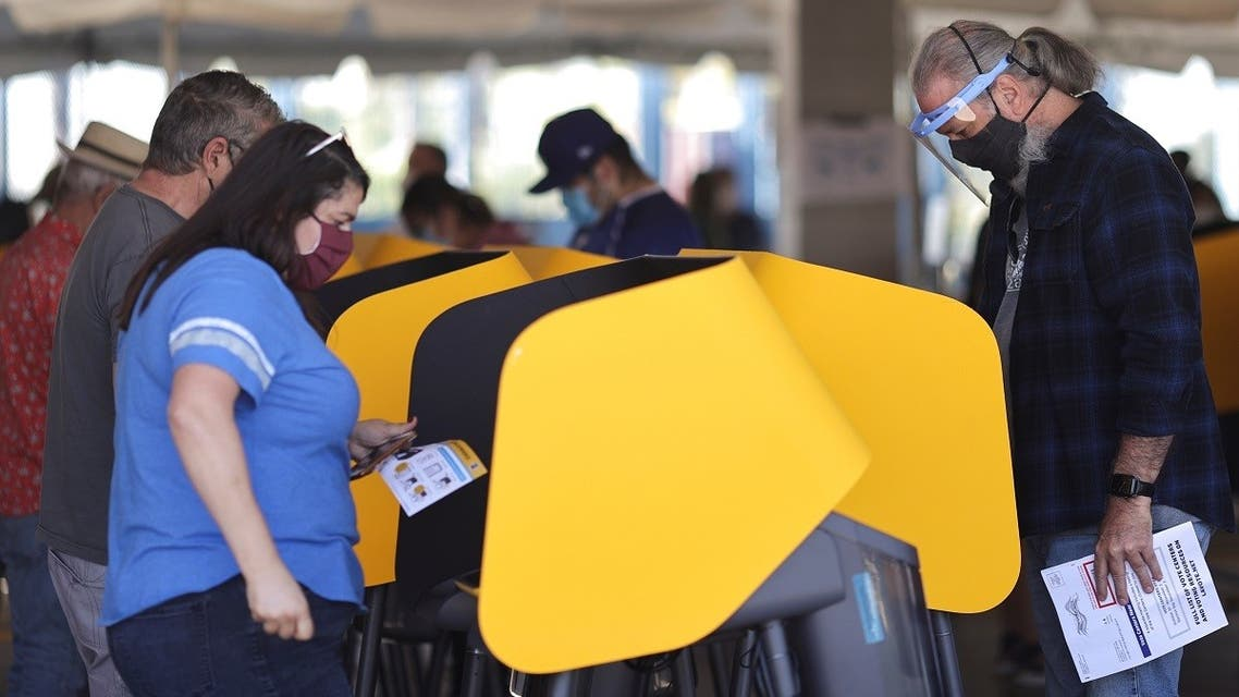 People vote in the US presidential election on the first day of expanded California in-person voting, amid the global outbreak of the coronavirus, at Dodger Stadium sports venue in Los Angeles, California, US, on October 30, 2020. (Reuters)