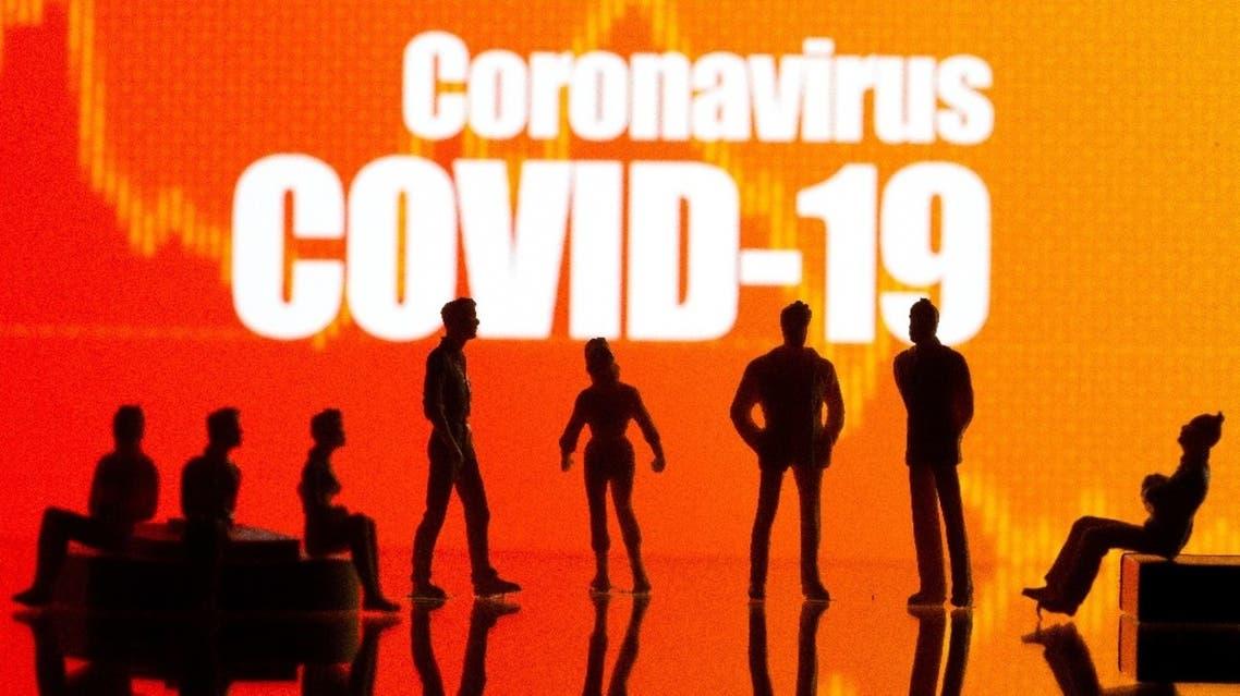 Small toy figures are seen in front of a Coronavirus Covid-19 and stock graph logo in this illustration taken, September 9, 2020. (Reuters)