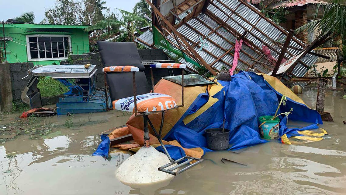 The remains of a barbershop is surrounded by floods in Pola town on the island of Mindoro, central Philippines on Oct. 26, 2020. (AP)