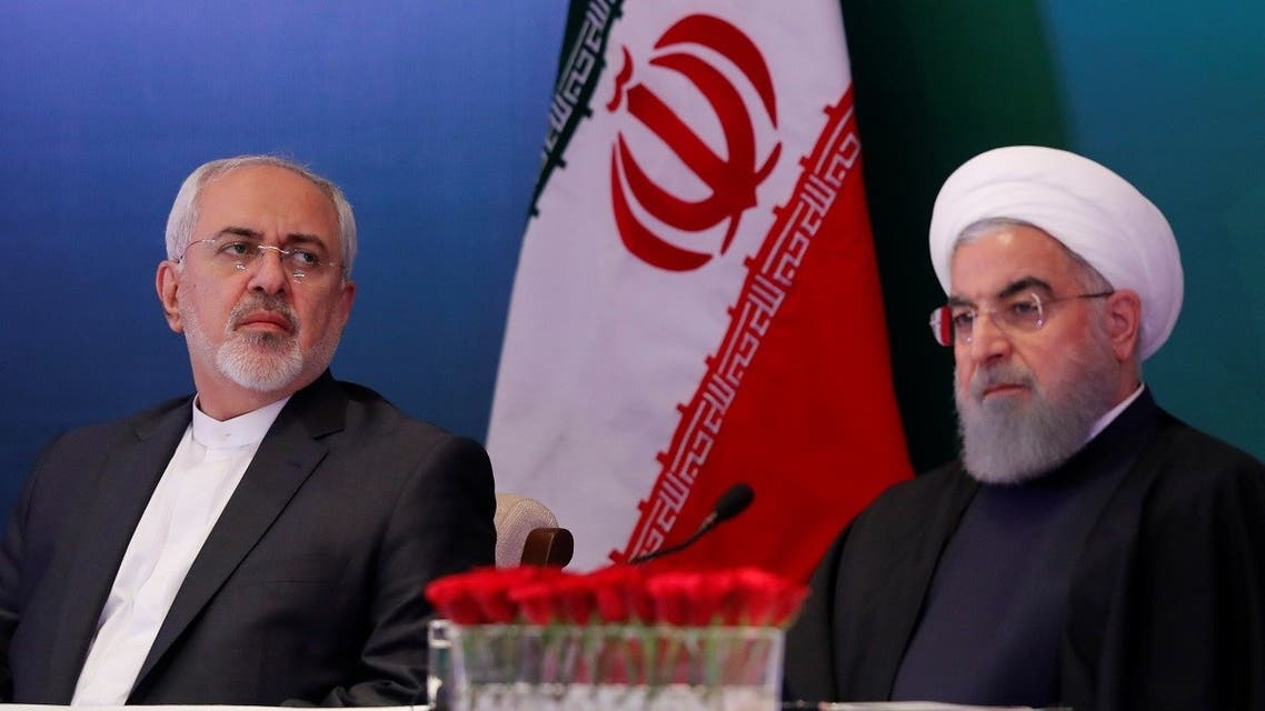 Iranian President Hassan Rouhani (R) and Foreign Minister Mohammad Javad Zarif attend a meeting with Muslim leaders and scholars in India, Feb. 15, 2018. (Reuters)
