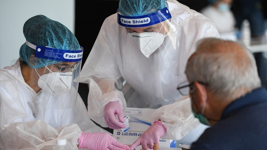 A man is tested for the novel coronavirus COVID-19 at the National Arena stadium in Bucharest on June 10, 2020. (Daniel Mihailescu/AFP)