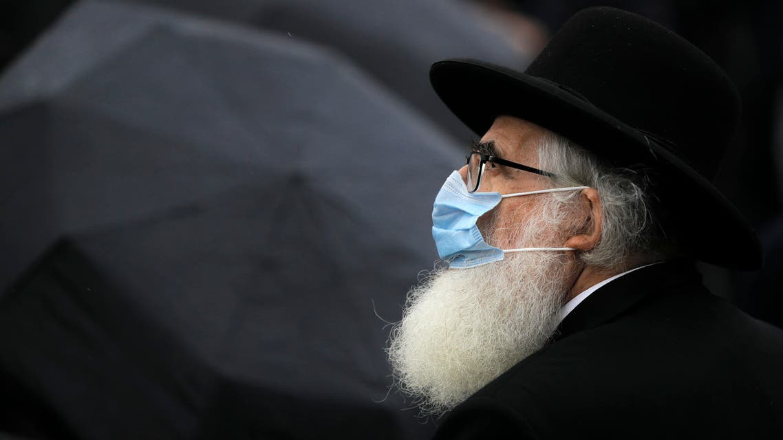 Rabbi Rafael Schaffer stands outside the Holocaust memorial during the National Holocaust Remembrance Day commemorations in Bucharest on Oct. 9, 2020. (AP)