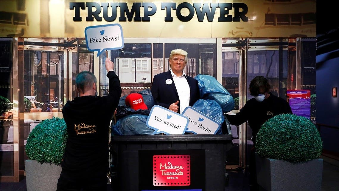 A wax figure depicting US President Donald Trump is put into a dumpster at Madame Tussauds in Berlin, Oct. 30, 2020. (Reuters)