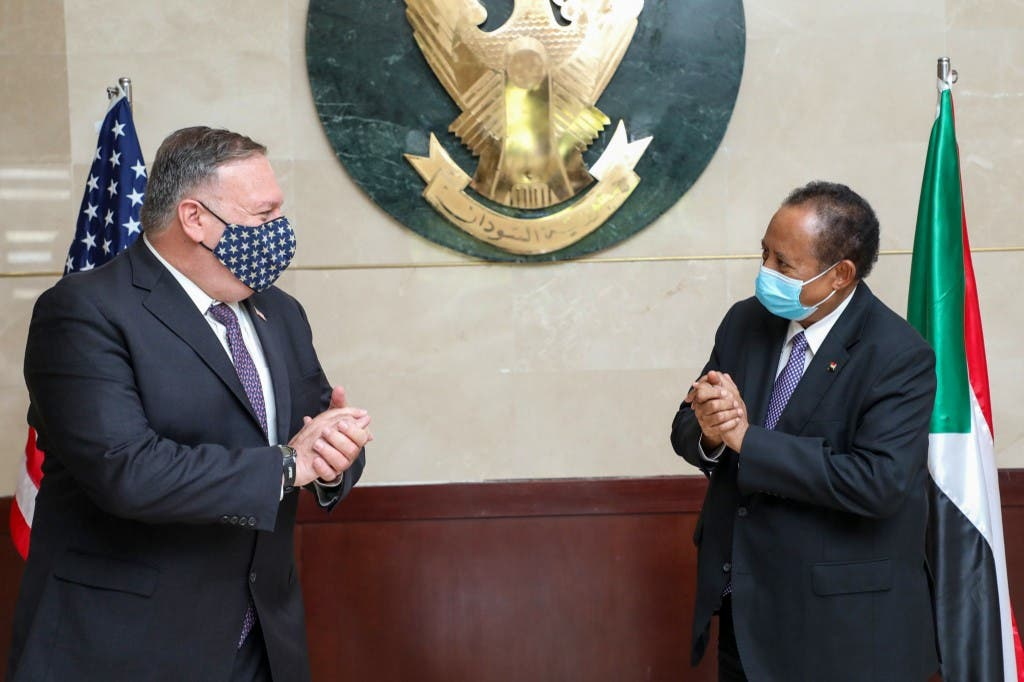 US Secretary of State Mike Pompeo (L) greeting Sudanese Prime Minister Abdalla Hamdok (R) in Khartoum. (AFP)