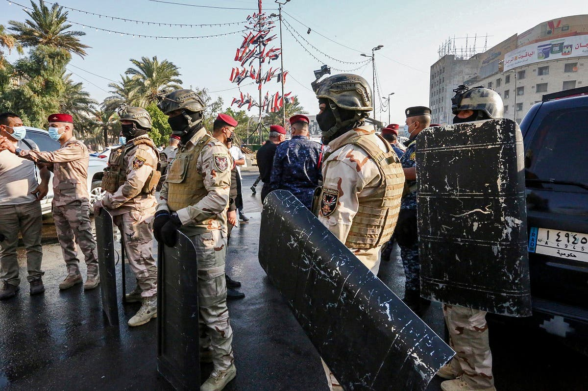 Members of the Iraqi security forces stand guard during the reopening of the Iraqi capital Baghdad's central Tahrir Square on October 31, 2020. (Sabah Arar/AFP)