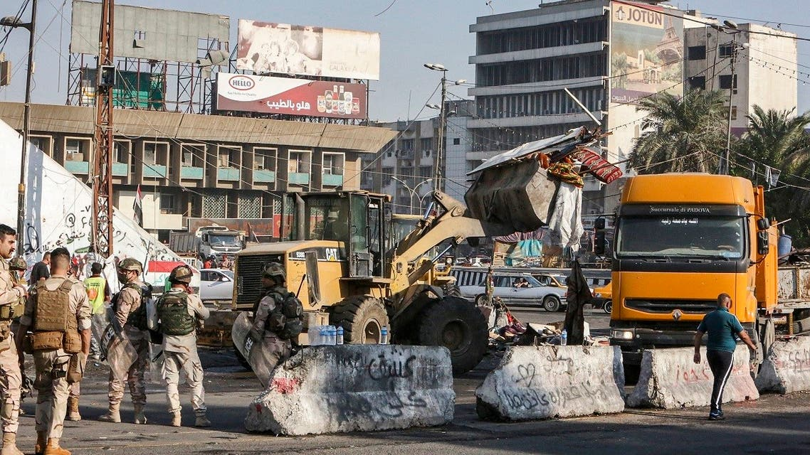 A bulldozer clears a path during the reopening of the Iraqi capital Baghdad's central Tahrir Square on October 31, 2020. (Sabah Arar/AFP)
