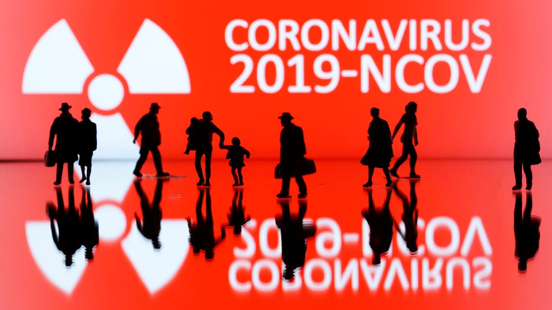 Small toy figures are seen in front of the coronavirus sign in this illustrations taken February 7, 2020. (Reuters)