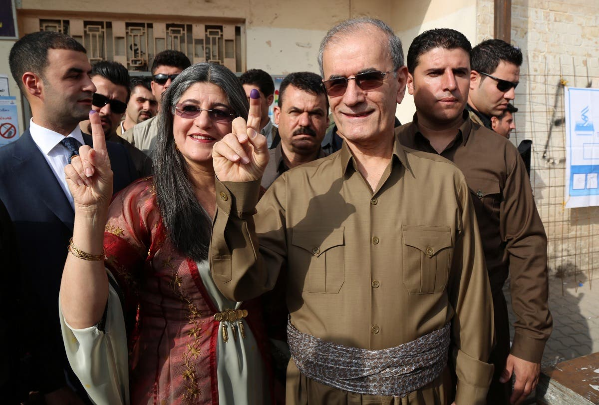 A file photo of Kirkuk provincial Governor Najmeddin Karim (R) shows his ink-stained finger after casting his vote in the Kurdish independence referendum in the city of Kirkuk in northern Iraq, on September 25, 2017. (Marwan Ibrahim/AFP)