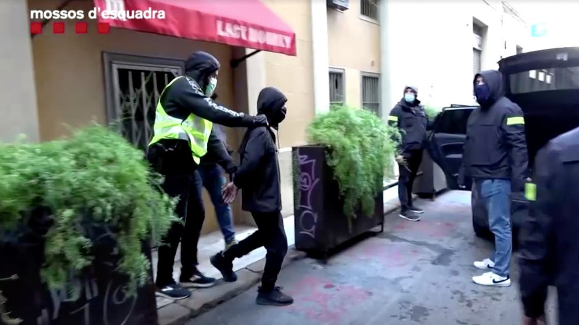 Catalan police officers arrest a man for praising the beheading of a French schoolteacher outside Paris this month, in this frame grab taken from Catalan police handout video shot on October 30, 2020, in Barcelona, Spain. (Reuters)