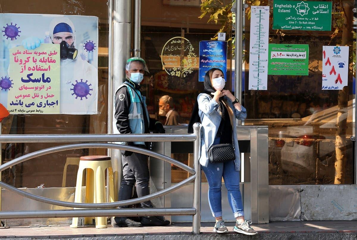 Iranians wear face masks as a coronavirus precaution, in Iran's capital Tehran on October 14, 2020. (AFP)