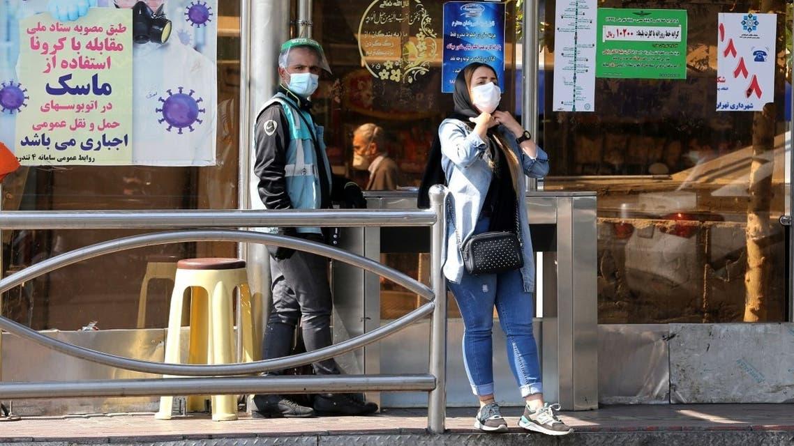 Iranians wear face masks as a coronavirus precaution, in Iran's capital Tehran on October 14, 2020. (Atta Kenare/AFP)