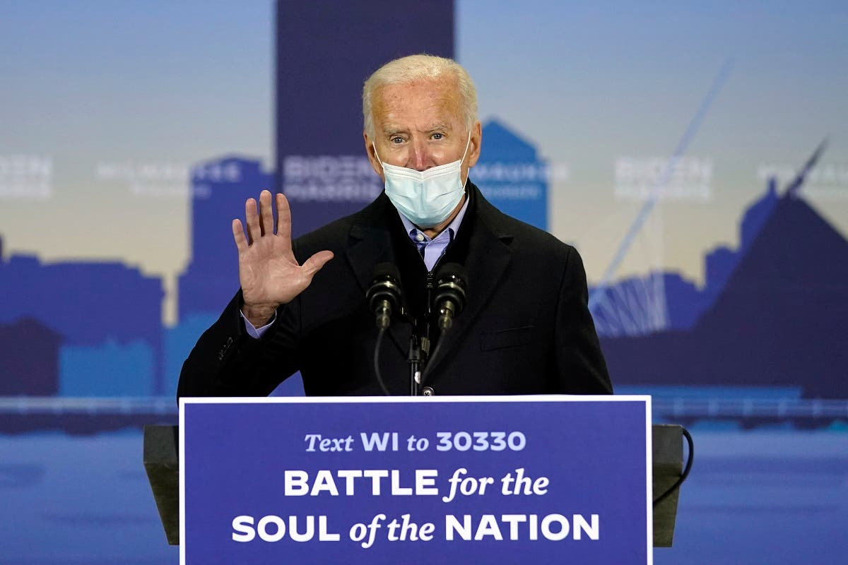 Democratic presidential candidate Joe Biden speaks in a hanger at General Mitchell International Airport, Oct. 30, 2020, in Milwaukee. (AP)