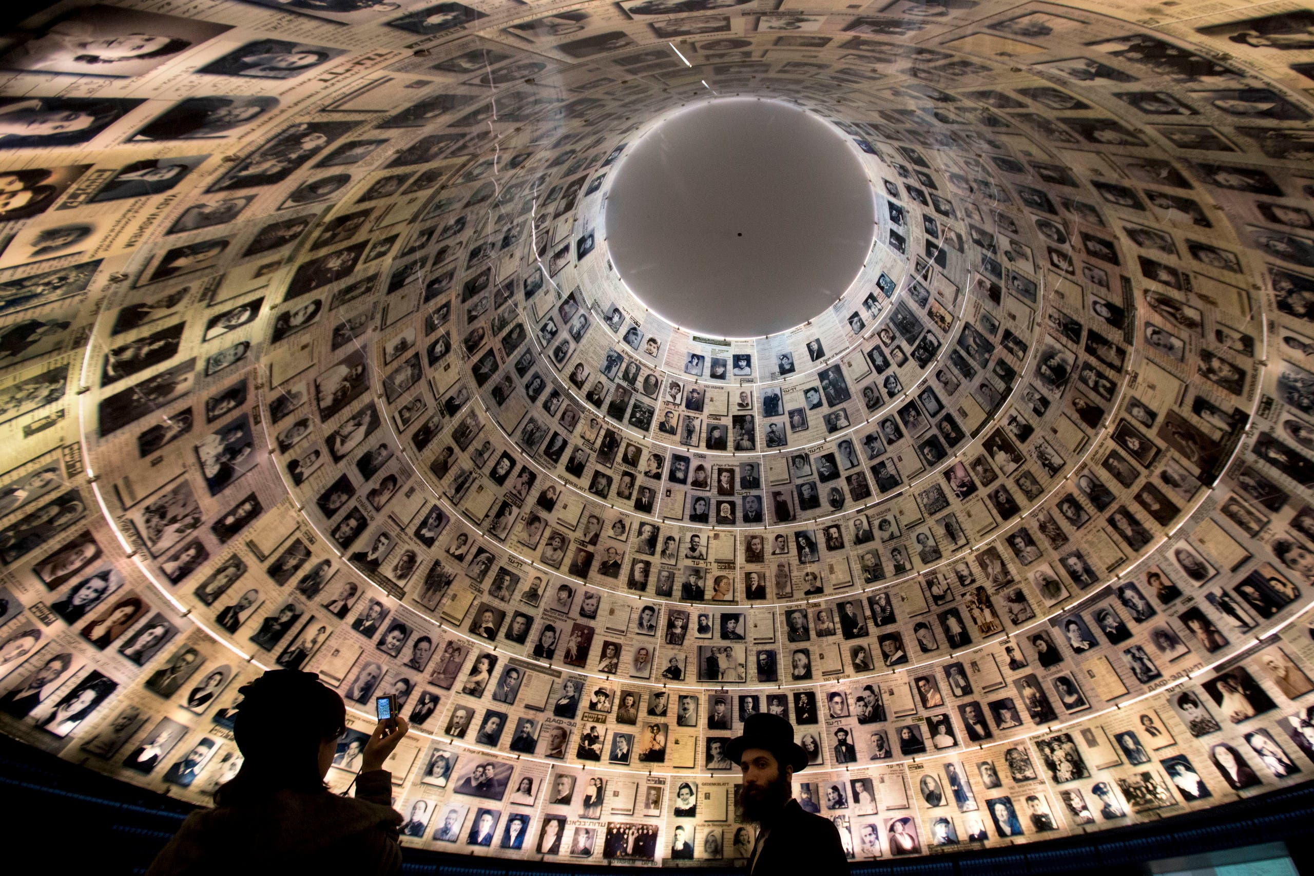 An ultra-Orthodox Jewish couple visits the Hall of Names at the Yad Vashem Holocaust memorial in Jerusalem, ahead of the International Holocaust Remembrance Day on Jan. 26, 2014. (AP)