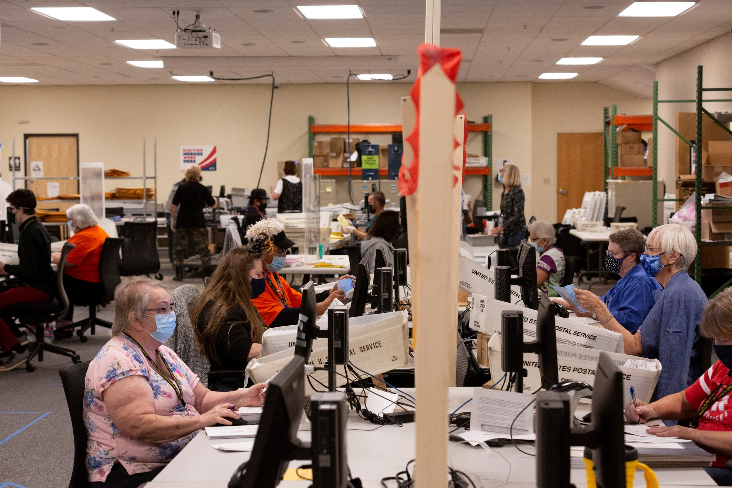 A file photo of early voting and absentee ballots are processed in Tucson, Arizona, US, October 31, 2020. (Reuters)