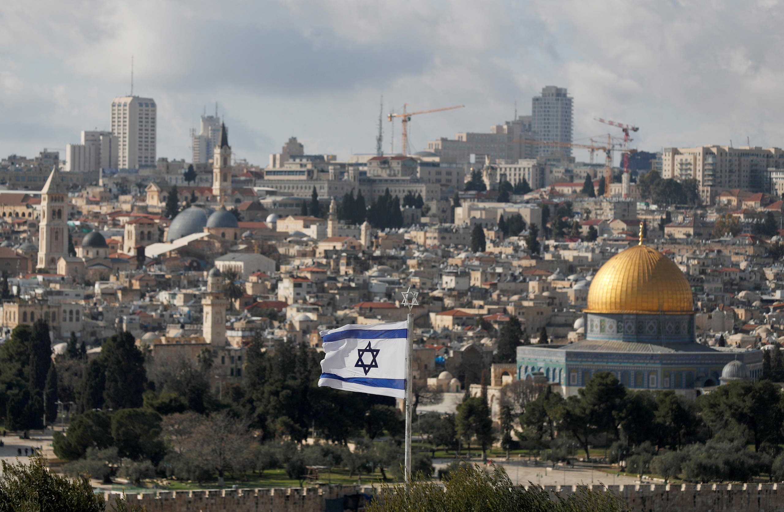 An Israeli flag is seen near the Dome of the Rock, located in East Jerusalem on January 24, 2020. (Reuters)