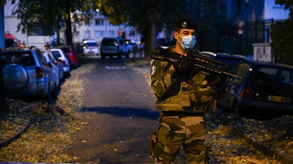 A French soldier stands behind a cordon on October 31, 2020 in Lyon near the scene where an attacker armed with a sawn-off shotgun wounded an Orthodox priest in a shooting before fleeing, said a police source. (AFP)