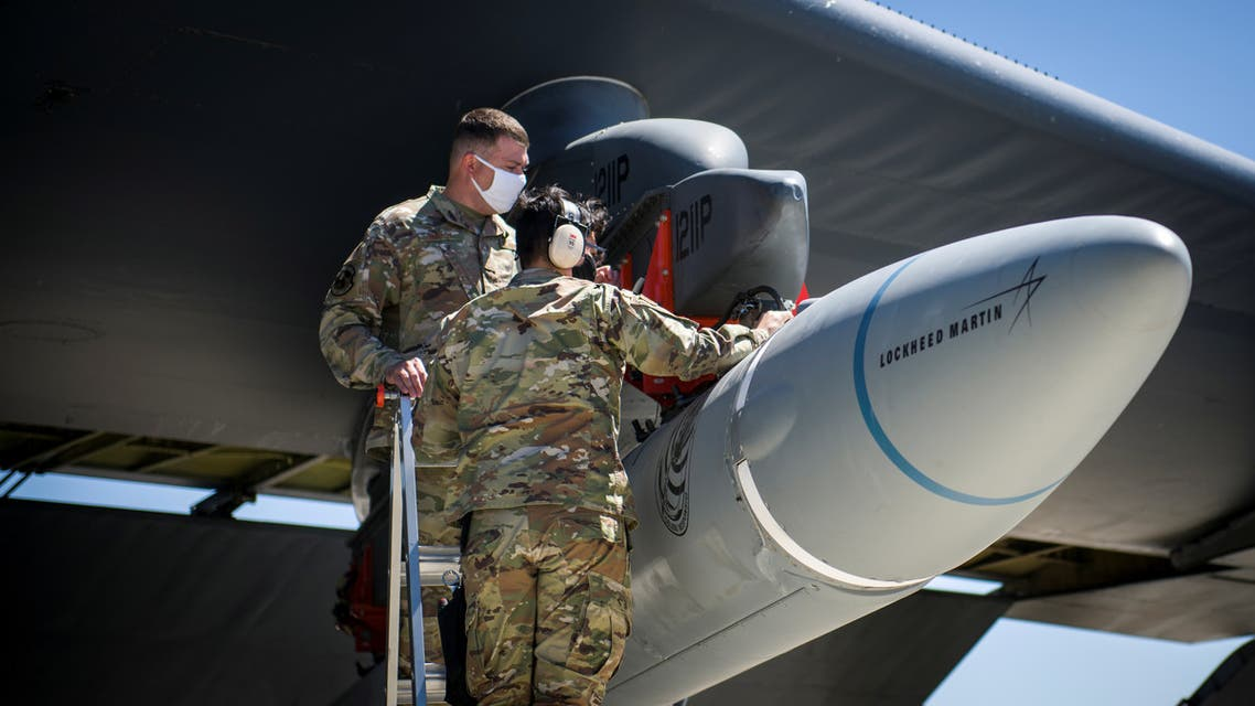 Master Sgt. John Malloy and Staff Sgt. Jacob Puente, both from 912th Aircraft Maintenance Squadron, secure the AGM-183A Air-launched Rapid Response Weapon Instrumented Measurement Vehicle 2 (ARRW IMV-2) as it is loaded under the wing of a B-52H Stratofortress at Edwards Air Force Base, California, U.S., August 6, 2020. Picture taken August 6, 2020. U.S. Air Force/Giancarlo Casem/Handout via REUTERS ATTENTION EDITORS - THIS IMAGE HAS BEEN SUPPLIED BY A THIRD PARTY. To match Special Report USA-CHINA/BOMBERS